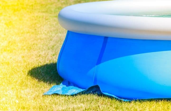 How to not kill grass with an inflatable pool: put a tarp underneath.