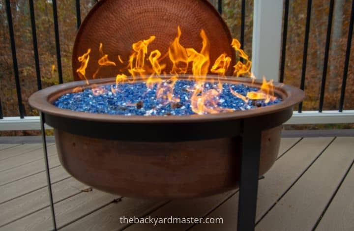 Raised fire pit on wooden deck